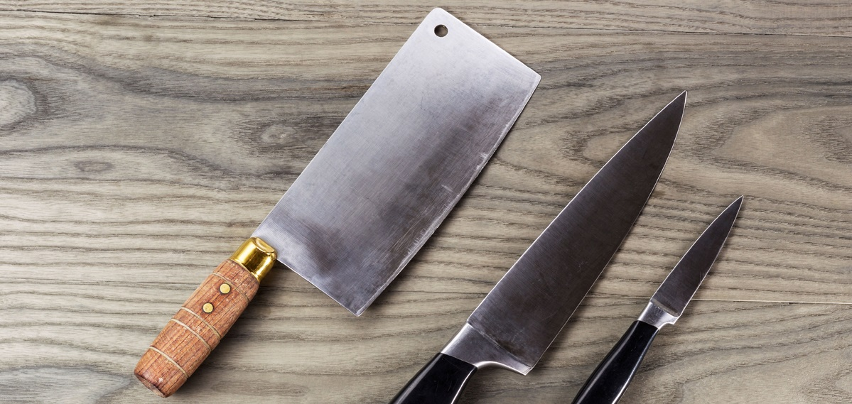Butcher, paring and large knife set on fading white ash wood