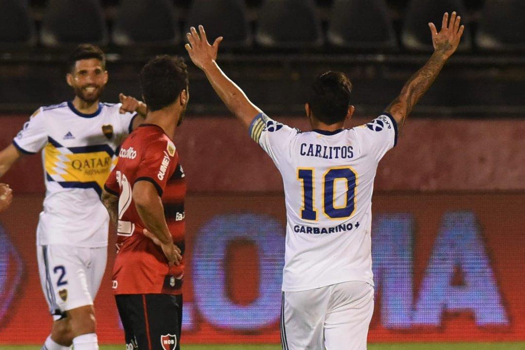 Tevez y Salvio festejan. Scocco lo sufre. (foto Pool Argra)